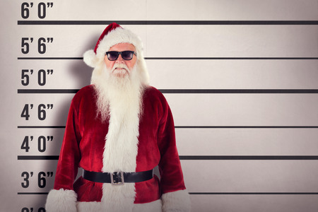 father in law: Santa Claus wears black sunglasses against mug shot background Stock Photo