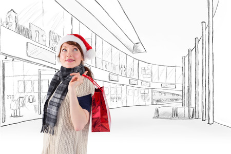 wearing santa hat: Smiling woman wearing santa hat against sketch design of a mall