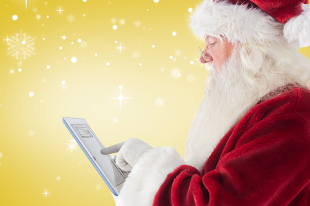 uses: Santa uses a tablet PC against yellow vignette