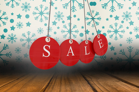 red wallpaper: Red sale tags against snowflake wallpaper over floor boards