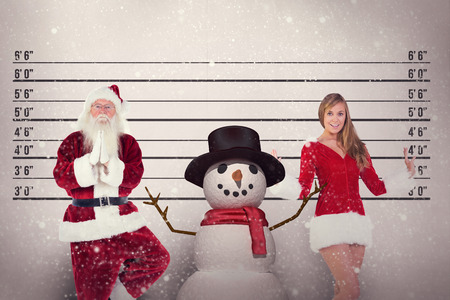 arresting: Father Christmas doing some yoga against mug shot background Stock Photo