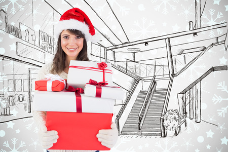 wearing santa hat: Attractive woman wearing santa hat with gifts against white background with vignette