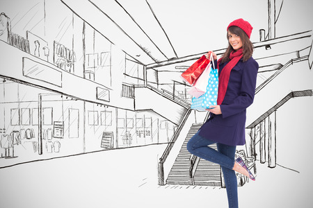 Happy brunette in winter clothes holding shopping bags against white background with vignette