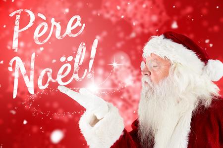 pere noel: Santa claus blowing against digitally generated delicate snowflake design