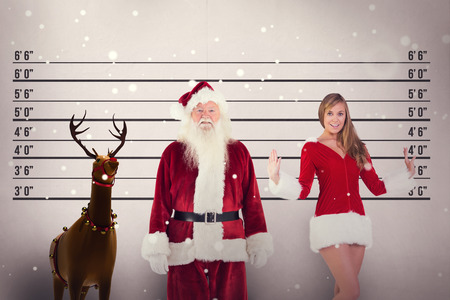 father in law: Jolly Santa smiling at camera against mug shot background