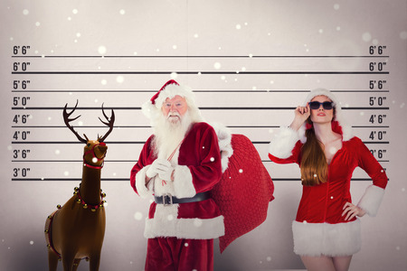 father in law: Santa carries his red bag against mug shot background