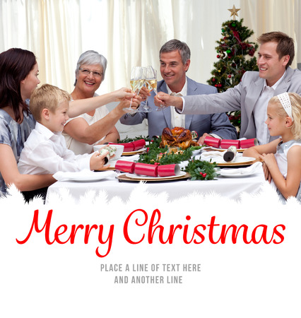 traditional christmas dinner: Family drinking a toast in a Christmas dinner against merry christmas Stock Photo