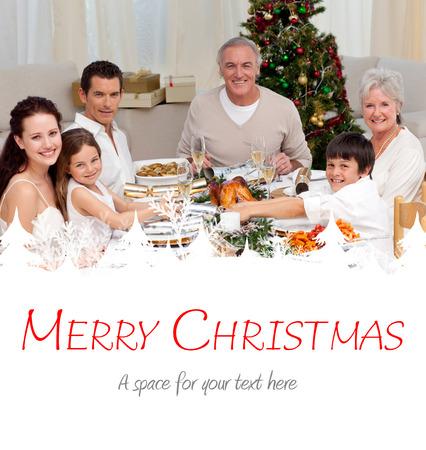 christmas cracker: Children pulling a Christmas cracker at home against merry christmas Stock Photo