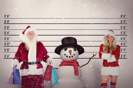arresting: Santa carries some Christmas bags against mug shot background
