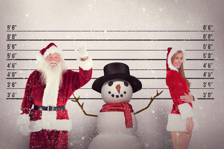 arresting: Jolly Santa waving at camera against mug shot background Stock Photo