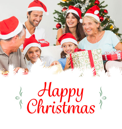 swapping: Composite image of happy family at christmas swapping gifts against border Stock Photo