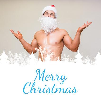fake christmas tree: Portrait of shirtless macho man with fake santa beard against merry christmas