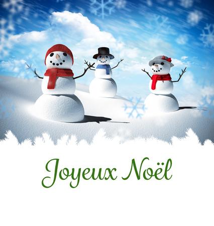 joyeux: Joyeux noel against snow man family Stock Photo
