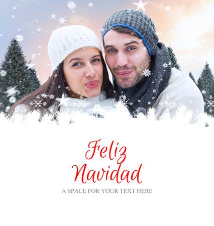 feliz: young winter couple against feliz navidad