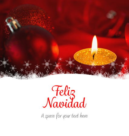 feliz navidad: Feliz navidad against golden tea light candle with christmas decorations