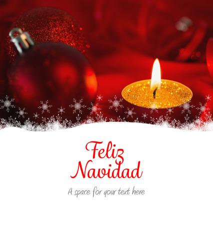 navidad navidad: Feliz navidad against golden tea light candle with christmas decorations