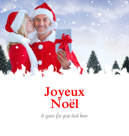 joyeux: festive couple against joyeux noel Stock Photo