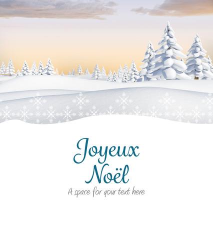 Joyeux noel against snowy landscape with fir trees Stock Photo