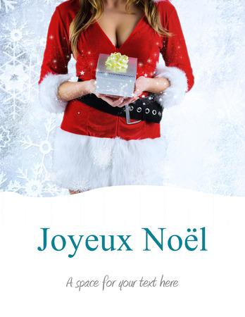 sexy santa girl: sexy santa girl holding gift against joyeux noel