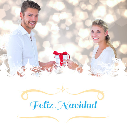 love tree: young couple with gift against Christmas greeting card