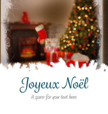 joyeux: Joyeux noel against christmas home seen through frosty window Stock Photo