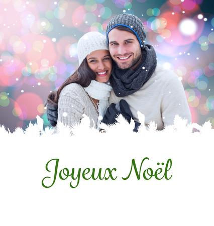 joyeux: young winter couple against joyeux noel