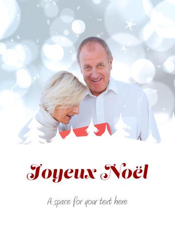 joyeux: couple with shopping bag against joyeux noel
