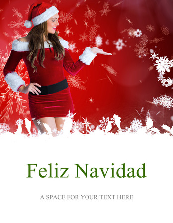 pere noel sexy: pretty girl in santa costume holding hand out against feliz navidad