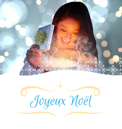 sexy santa girl: sexy santa girl opening gift against Christmas greeting card Stock Photo