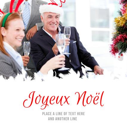 joyeux: Businessman team celebrating christmas  against joyeux noel
