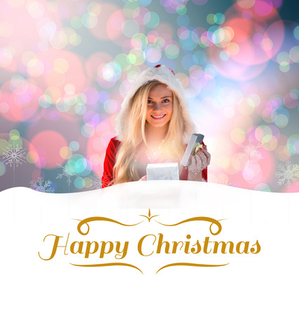 sexy santa girl: sexy santa girl opening gift against border Stock Photo