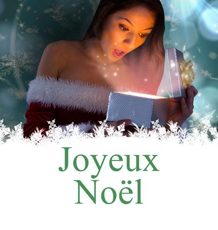 joyeux: sexy santa girl opening gift against joyeux noel