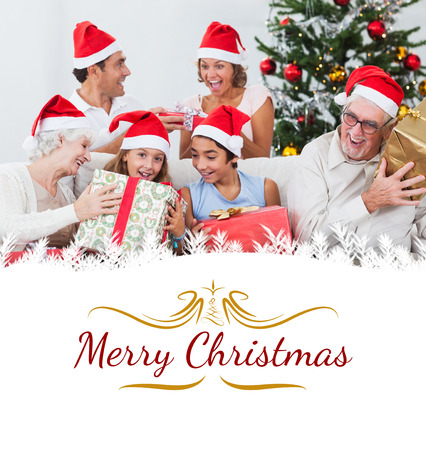 swapping: Family swapping christmas presents against border Stock Photo