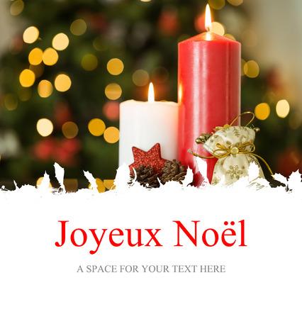 joyeux: Joyeux noel against focus on christmas candles and decorations Stock Photo