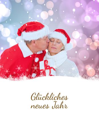 neues: festive mature couple holding gift against glückliches neues jahr
