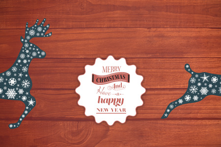 floorboard: Logo wishing a merry christmas against overhead of wooden planks