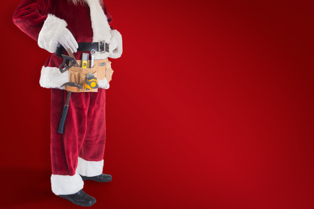 pere noel: Father Christmas is wearing a tool belt against red background