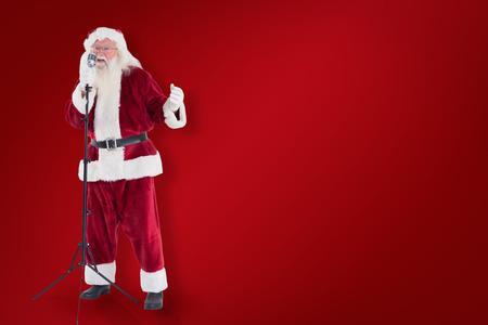 superstar: Santa sings like a Superstar against red background