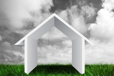 grey  sky: House outline against green grass under grey sky Stock Photo