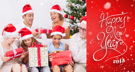 exchanging: Excited family exchanging gifts at christmas against red vignette Stock Photo