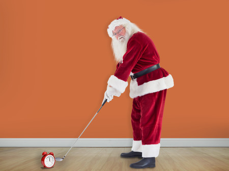 christmas golf: Santa Claus is playing golf  against room with wooden floor