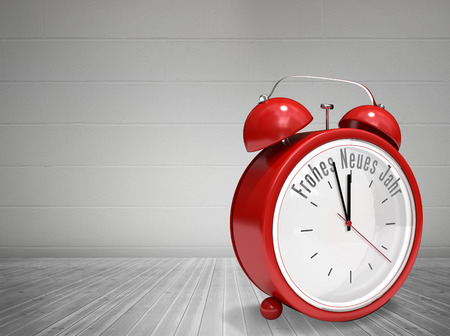 neues: Frohes neues jahr in red alarm clock against grey room Stock Photo