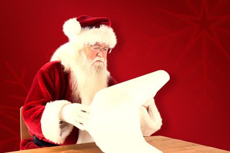 home trainer: Santa reads a long list against red background