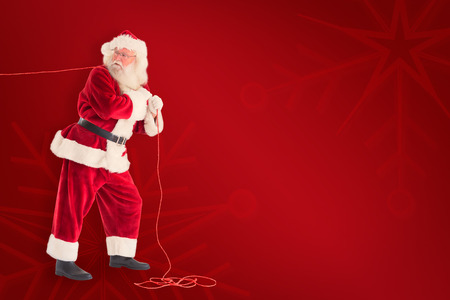 home trainer: Santa pushes a shopping cart against red background