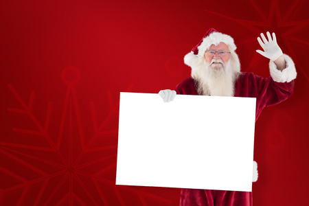 christmas golf: Santa holds a sign and is waving against red background Stock Photo