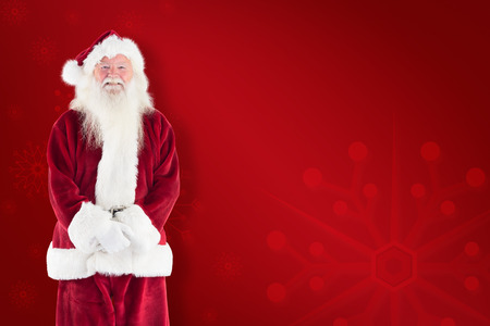 home trainer: Jolly Santa smiling at camera against red background
