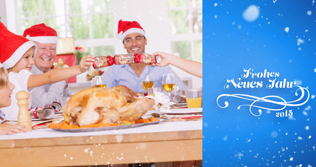 christmas cracker: Siblings pulling a christmas cracker against blue vignette