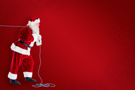lean back: Santa pushes a shopping cart against red background