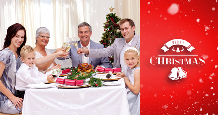 traditional christmas dinner: Family tusting in a Christmas dinner against red vignette
