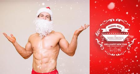 macho: Portrait of shirtless macho man with fake santa beard against red vignette